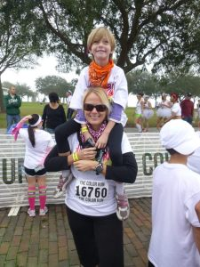 Jenny and one of her kids after a Color Run!