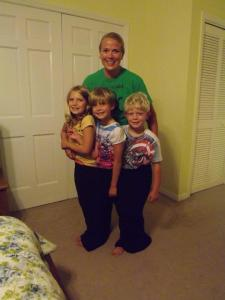 Jenny and her 3 kids in the pants she used to wear.