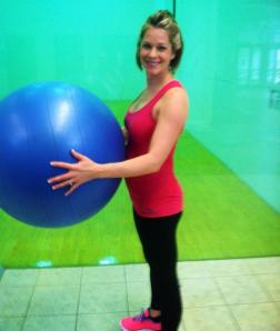 I like to stand next to exercise balls at this stage of pregnancy -- makes me look thin. LOVE my FittaMamma shirt too!